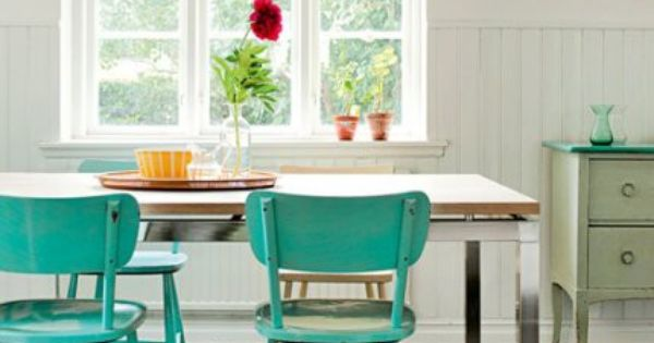 Turquoise chairs. Love the touch of color against the white walls.