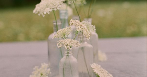 queen annes lace and bottles centerpiece