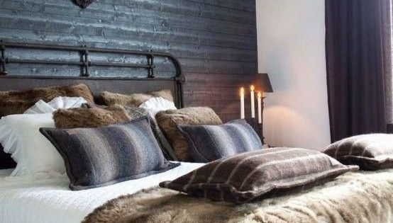 Masculine Bedroom Decor With Faux Fur Pillows And Throw