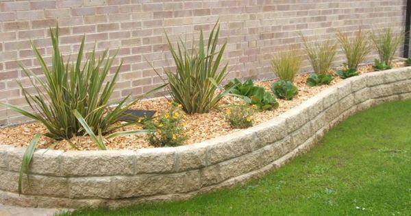 Low maintenance landscape design raised wall beds for Low maintenance plants for garden beds