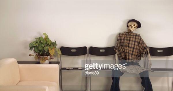 Skeleton Man Sitting Waiting Room With Newspaper Man Sitting