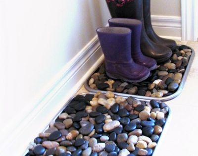 River rock mat to catch wet, messy shoes, umbrellas, etc. Great idea