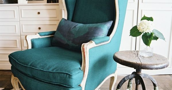 teal chair. side table. chevron rug.