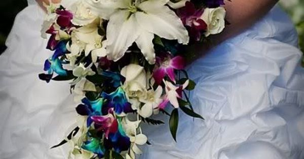 Draping bouquet but with different flowers possibly orchids?