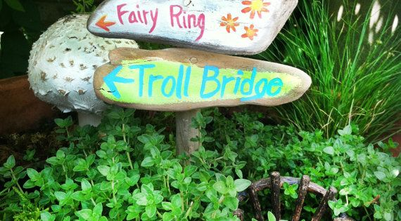 fairy garden signpost, painted signs fairy ring, snail trail, troll bridge on