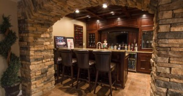 The Metzgersu0027 Basement Bar, Framed By The Stone Archway Thatu0027s The  Centerpiece Of The Room. | Basement Bar | Pinterest | Stone Archway,  Basements And Room