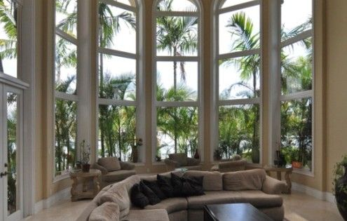A sunroom with really high ceilings.