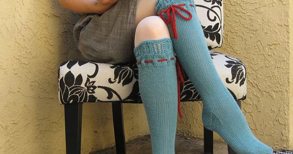 Hand knit knee socks with contrasting ties are interesting.