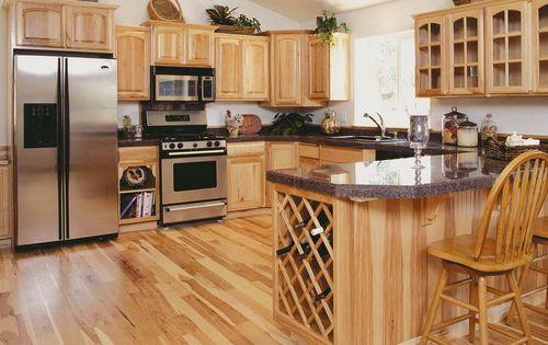 hickory kitchen cabinets with dark granite countertops