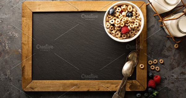 Healthy cold cereal with raspberry and blueberry in a bowl background with chalkboard overhead shot (Cheerios inspired)