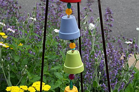 A bell tower wind chime, made from miniature clay pots. Learn how