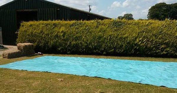 Diy swimming pool from bales of hay diy swimming pool for Hay bail pool