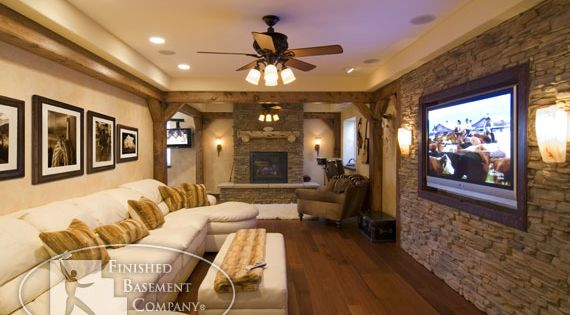 Cool basement--love the stone wall. Man cave ideas for Matt!