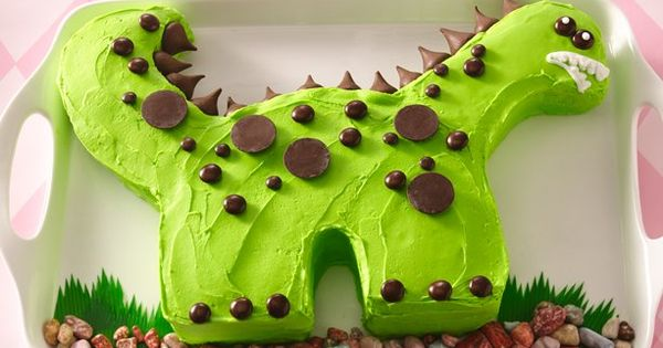 Dinosaur birthday cake. The spikes are hershey kisses - great idea!