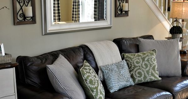 Decorating with a leather couch; Adding a mirror above the sofa is