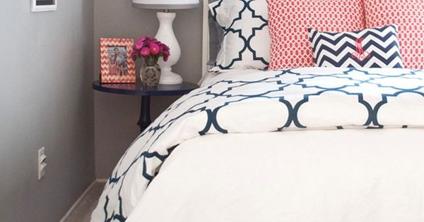 navy + coral bedroom. Potential guest room or sitting room color scheme.
