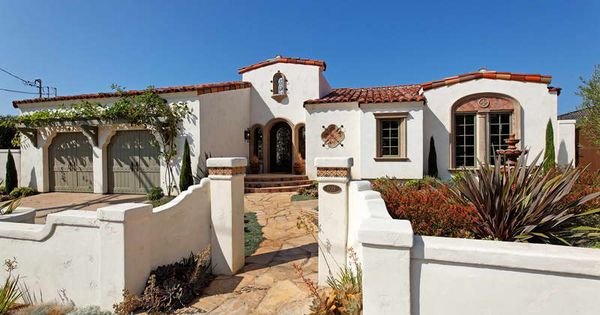 Corbel design of garage openings spanish colonial for Spanish revival exterior paint colors