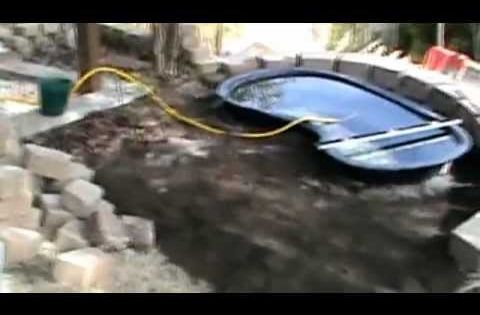 Installing a raised diy 220 gallon koi pond with water for Koi pond installation cost