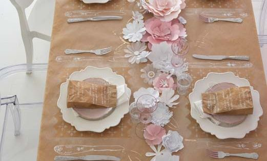 Kraft paper table cover, paper flowers, and paper bag favors.