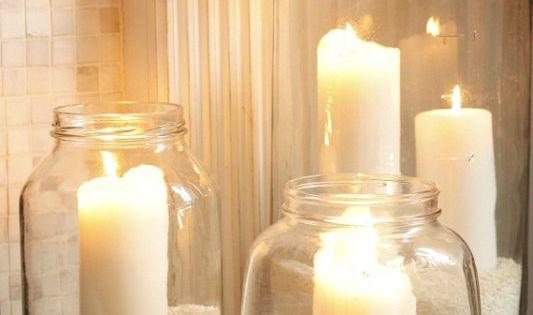 Sand, candles in a mason jar. Cute idea for a beach house!