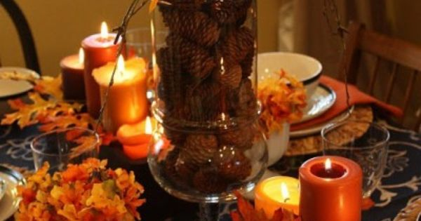 Gorgeous fall table setting - Pinecones in a clear vase topped with
