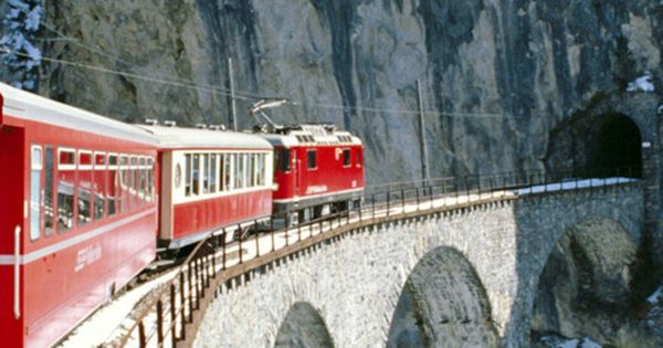 Switzerland, the red train. Imagine that view-sipping a hot mug of swiss