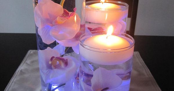 Flowers in water and floating candles could be simple and pretty for