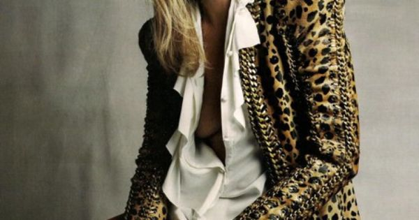 Kate Moss wearing red leather pants, leopard print jacket and white shirt