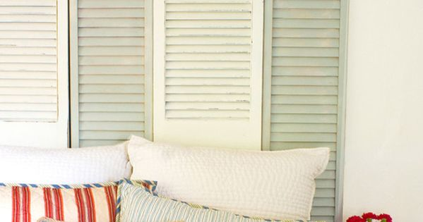 Beach house decor... Love the shutters headboard