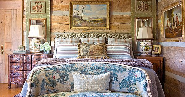 An antique settee at the foot of the bed introduces a wash for Charles faudree antiques and interior designs