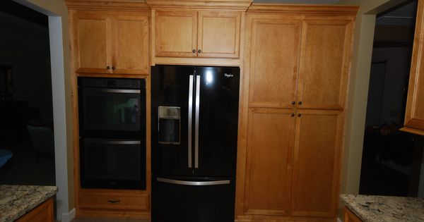 Starmark maple bethany in butterscotch stain with for Chocolate kitchen cabinets with stainless steel appliances