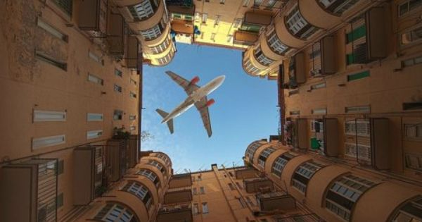 Just a photo of an airplane over a building. Talk about perfect