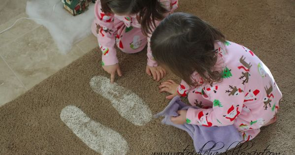 Santa Footprints = Baking soda and Glitter ... What a way to