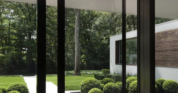 OMG This is our pivot door. New Canaan Residence by Specht Harpman