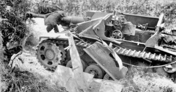 German 50 Mm Anti Tank Gun: A Destroyed German Stugg Anti-tank Gun. One Of The Crew Is