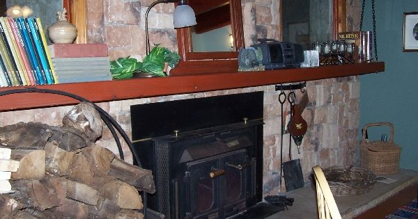 Fifteen foot long redwood beam suspended from the tongue for Tongue and groove fireplace