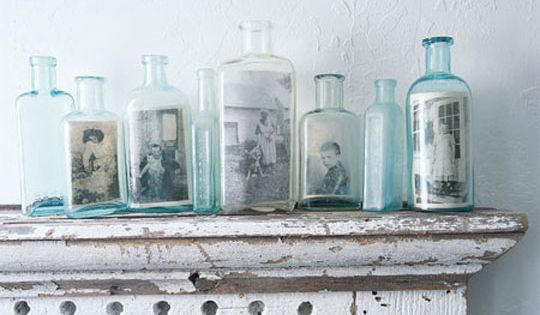 vintage photo display in bottles. gets you thinking outside the picture frame!