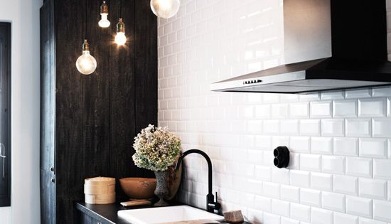 Black cabinets and white tiles in the kitchen - i LOVE white