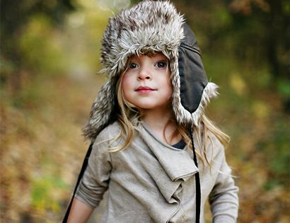 Little explorer in fur hat