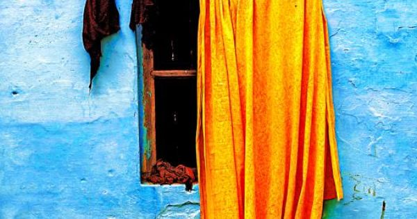 Blue Wall with Orange Sari - love the color combination