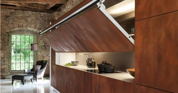 Don't love the hidden kitchen idea but really like the stone &