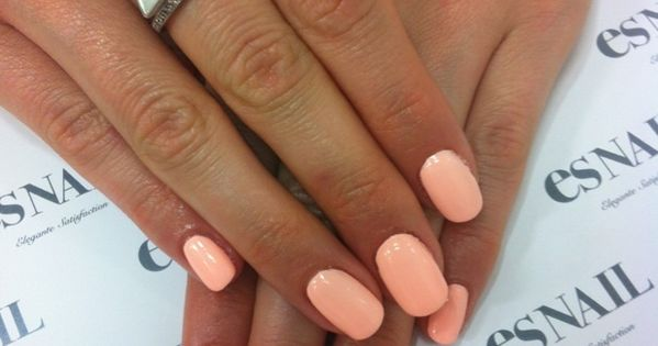 the perfect peach nail color. love those rings, too!