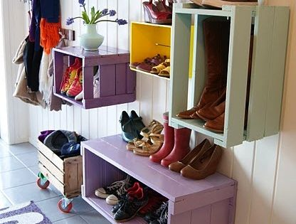 Old crates as shoe racks. Great for future mudroom