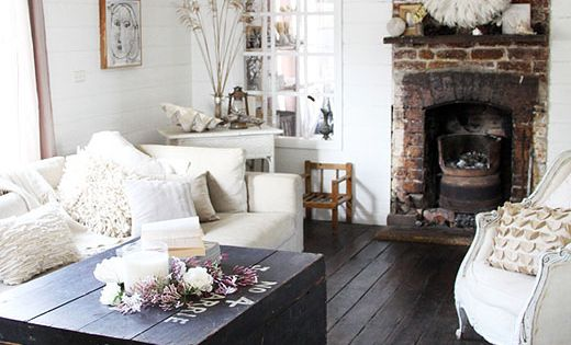 Living room. Dark wood floor, clean white walls and furniture. Brick fireplace