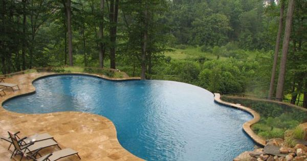 Pool landscape design with vanishing edge decks for Pool edges design