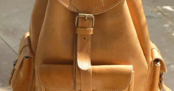 this natural leather backpack would go with me everywhere. Especially with my