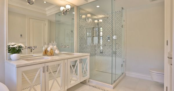 want glamour in your bathroom replace cabinet panels with mirrors and