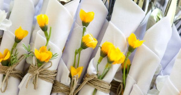 Use twine & a wildflower to tie silverware at the buffet or