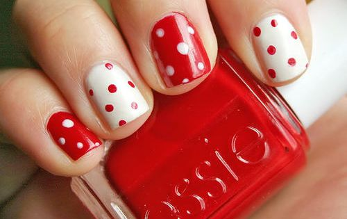 Valentines Day polka dot nail polish design concept in red and white.