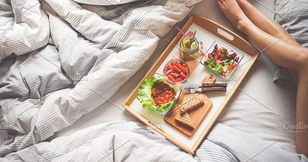 Young Woman Enjoying Morning Breakfast in Bed